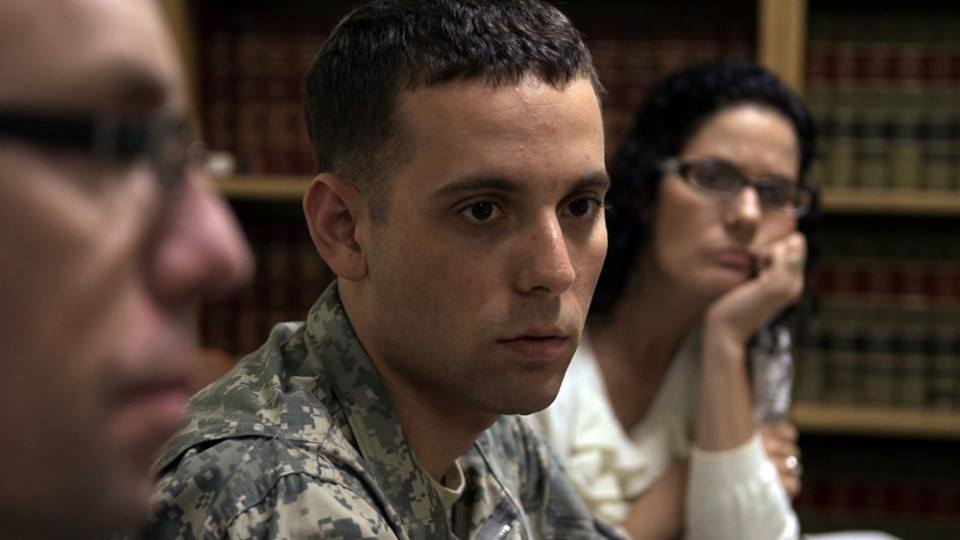 Adam Winfield in uniform, speaking to his lawyer.