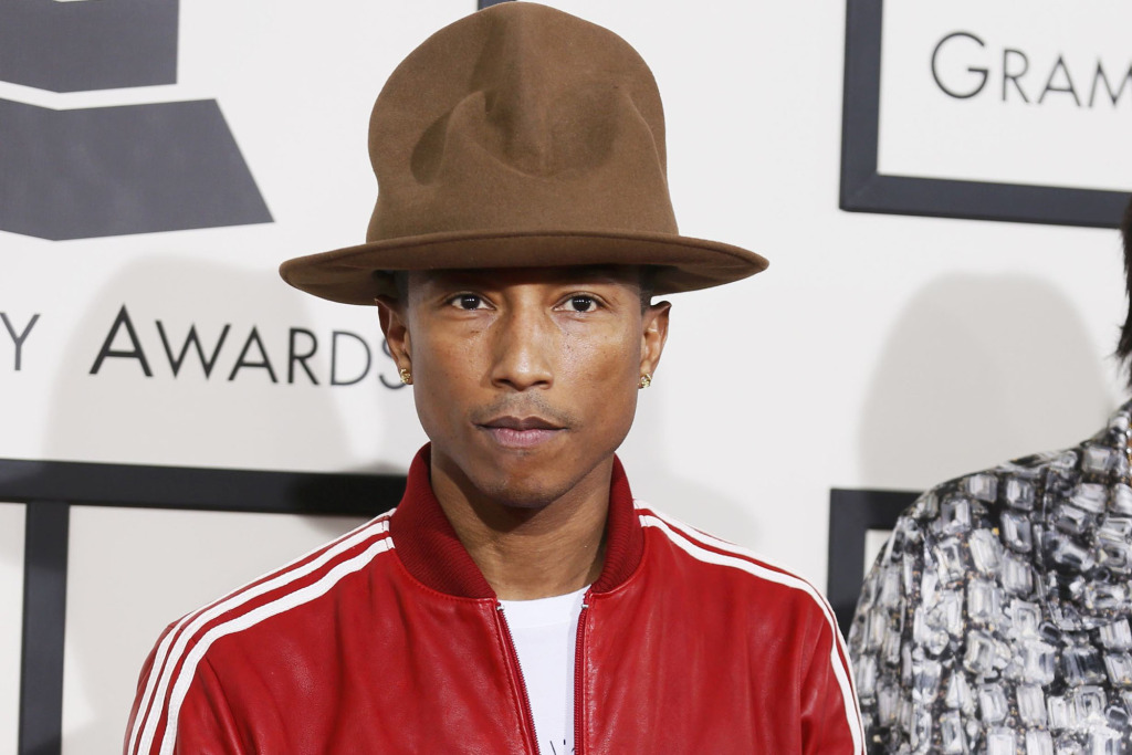 Pharrell Williams and Helen Lasichanh arrive at the 56th annual Grammy Awards in Los Angeles