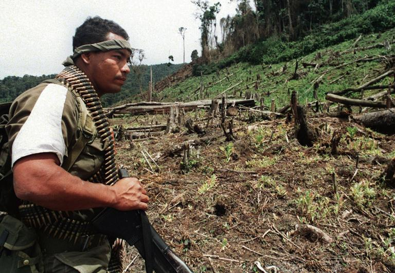 Columbian solider looks at deforestation. Photo Credit: National Geographic